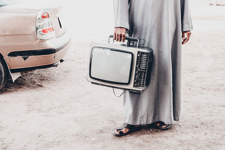 in his way to fix this old tvset at upper egypt Adult Adults Only Day Live For The Story Low Section Men Old TV Set Old-fashioned One Person Outdoors People Place Of Heart Standing The Photojournalist - 2017 EyeEm Awards The Street Photographer - 2017 EyeEm Awards The Portraitist - 2017 EyeEm Awards Investing In Quality Of Life Mix Yourself A Good Time Paint The Town Yellow Done That. Be. Ready. AI Now