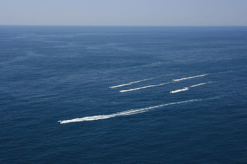 Few monor boats in tranquil sea in a sunny day. Beauty In Nature Blue Horizon Horizon Over Water Lifestyles Mode Of Transportation Motion Motor Boats Nature Nautical Vessel Scenics - Nature Sea Sky Summer Adventures Tranquil Scene Transportation Water Waterfront Weekend Activities