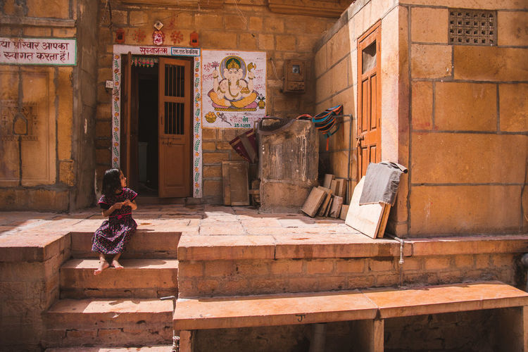 Stories from Jaisalmer ... Exploring Sunny Travel Lifestyles Life Kid Stories from the City Cultures Golden City Wall Built Structure Architecture Cultures Jaisalmer Rajasthan India Street Child Women Architecture Built Structure Entrance Entryway Entry Door Front Door Gate Open Door The Traveler - 2019 EyeEm Awards The Street Photographer - 2019 EyeEm Awards