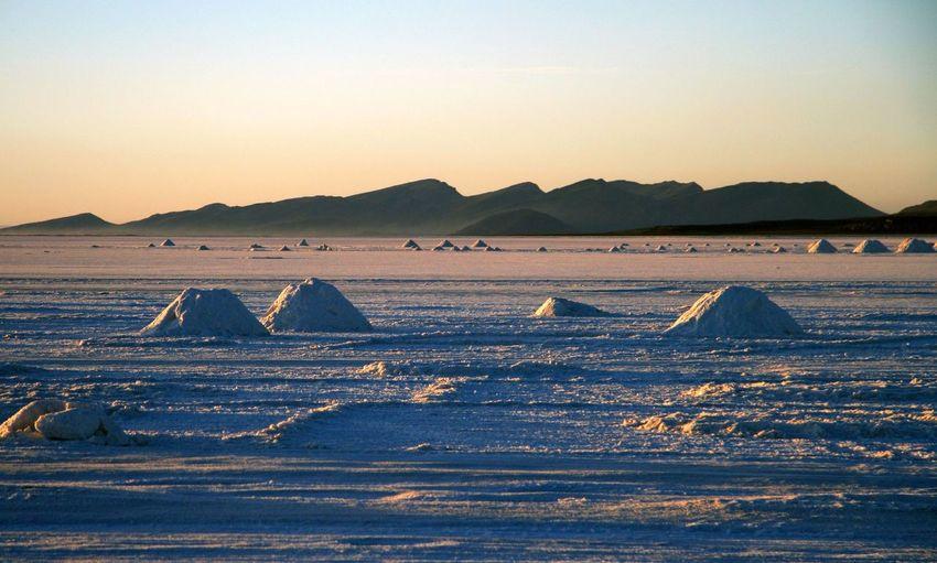 Heap Of Salts In Salt Flat Against Sky