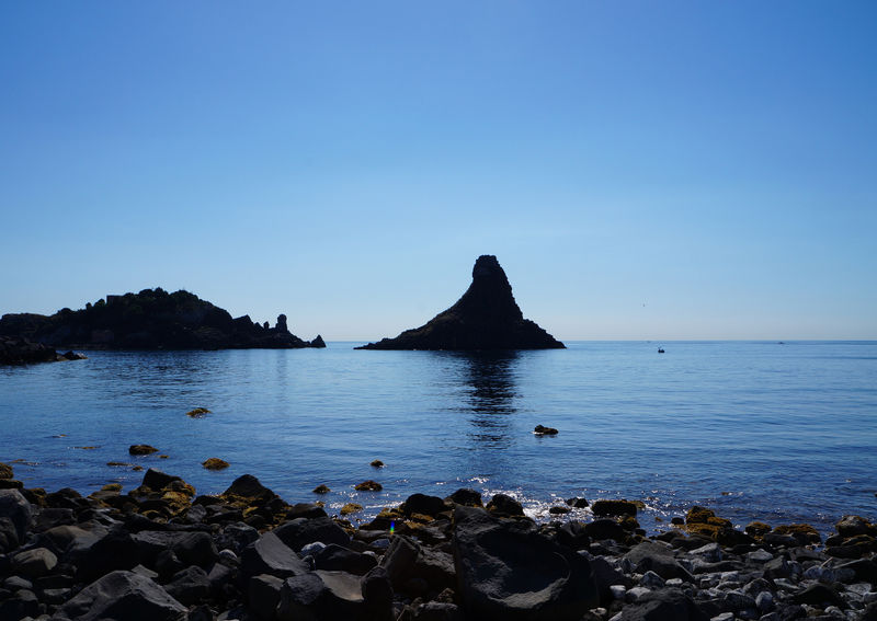 Catania, Sicily Cyclops' Coast Sicily, Italy Sicily's Riviera Dei Ciclopi Beauty In Nature Blue Clear Sky Day Horizon Over Water Mountain Nature No People Outdoors Riviera Dei Ciclopi Rock - Object Scenics Sea Sky Tranquil Scene Tranquility Water