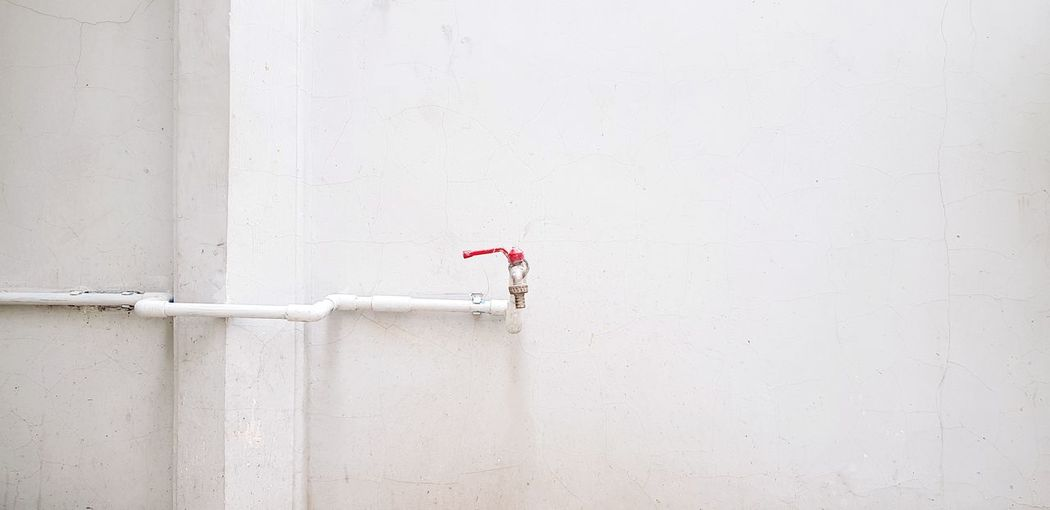 Water Public utility installed on white rough wall with copy space Built Structure Wall - Building Feature Architecture No People Building Exterior Pipe - Tube White Color Pipe Copy Space Water Pipe Connection Pipeline Outdoors Close-up Red Wall Home Improvement Copy Space Public Utility Water Pipeline Lines And Shapes EyeEmNewHere White