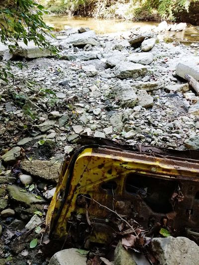 Ohio Day High Angle View Outdoors No People Nature Water Close-up Puddle Creek River Full Length Textured  Car Door Handle Textured  Rusted Rust Abandoned Yellow Car Yellow Car Window Car Door Growth