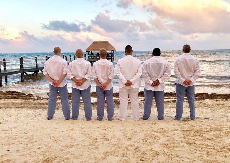 Views Casual Clothing Wedding Photography Guys Groom Wedding Beach Sea Men Cloud - Sky Sand Sky Sunset Full Length Togetherness Standing Large Group Of People Water Lifestyles Rear View Women Mature Adult Outdoors Friendship Day Real People