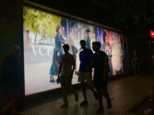 Boys walking Background Colorful Silouette Contraluz Group Of People Real People Night Architecture Creativity Graffiti People Full Length Men Women Lifestyles Art And Craft Adult Leisure Activity Indoors  Crowd Built Structure Illuminated Standing
