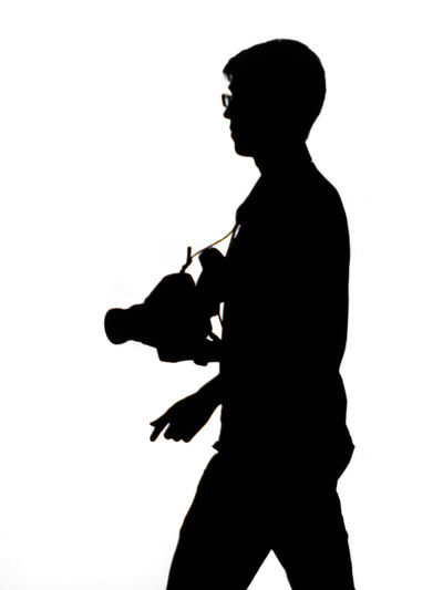 Side view of silhouette woman against white background