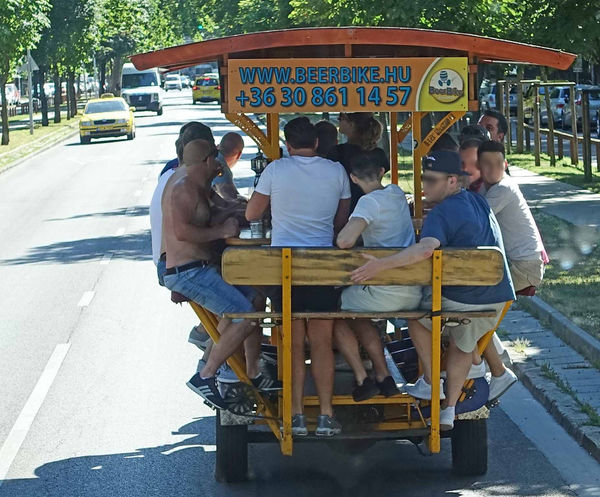 Budapest beer bike Adult Adults Only Beer Bike Budapest Streetphotography Day Land Vehicle Large Group Of People Lifestyles Men Mode Of Transport Outdoors People Real People Road Sitting Street Transportation Young Adult Let's Go. Together. Breathing Space