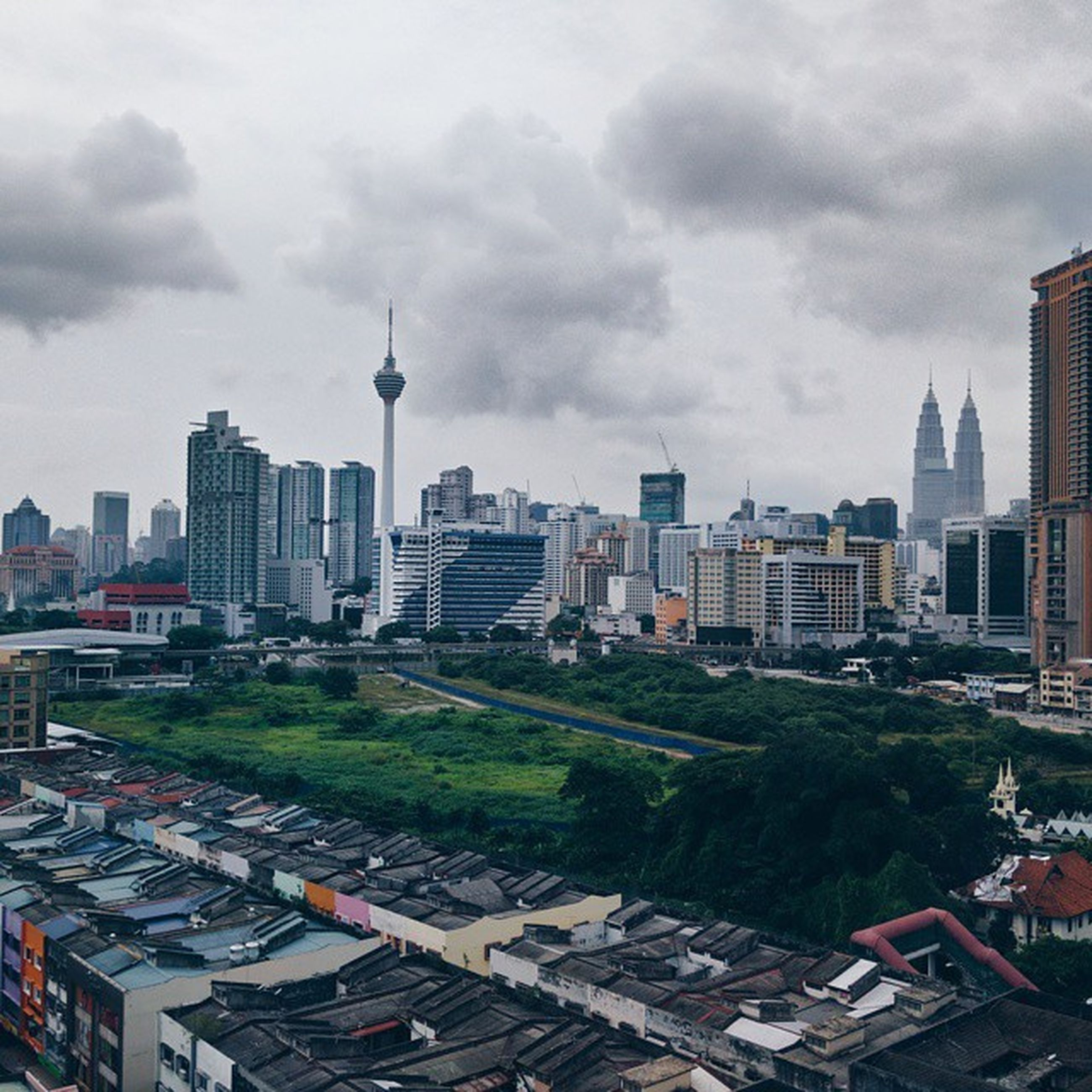 building exterior, architecture, built structure, city, sky, tower, cityscape, tall - high, cloud - sky, skyscraper, cloudy, capital cities, travel destinations, communications tower, city life, urban skyline, residential district, high angle view, office building, modern