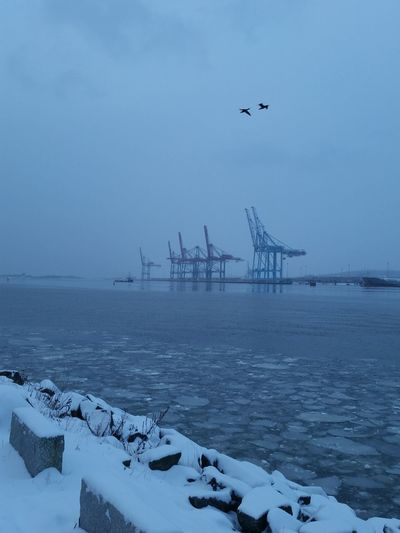 Sea Against Commercial Dock During Winter