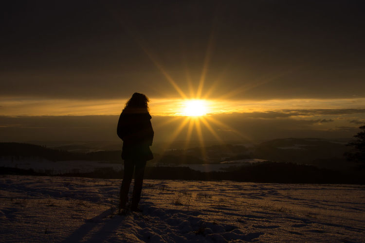 Cold Temperature EyeEm Best Shots EyeEm Nature Lover EyeEm Picture Of The Day One Person Scenics Silhouette Snow Sun Sunset Tranquil Scene Tranquility Watching The Scene Watching The Sunset Winter