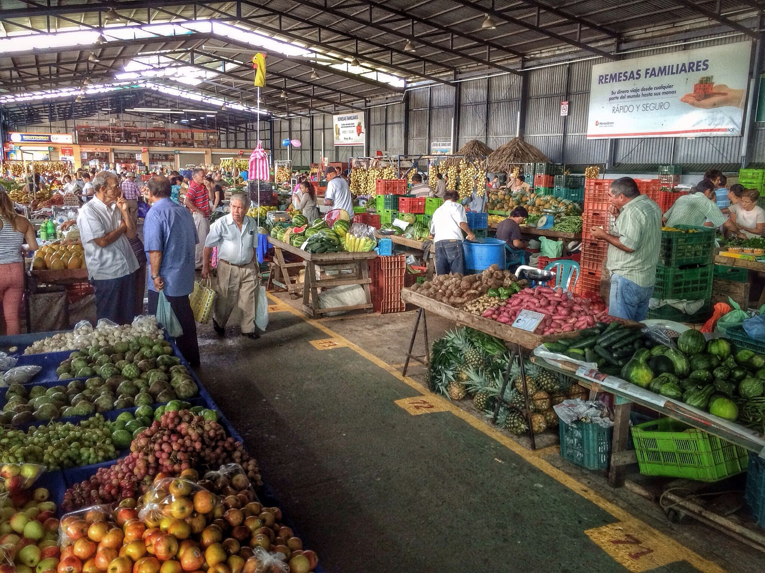 market, for sale, retail, market stall, large group of objects, abundance, building exterior, choice, high angle view, variation, architecture, store, display, built structure, small business, food and drink, sale, city, outdoors, food
