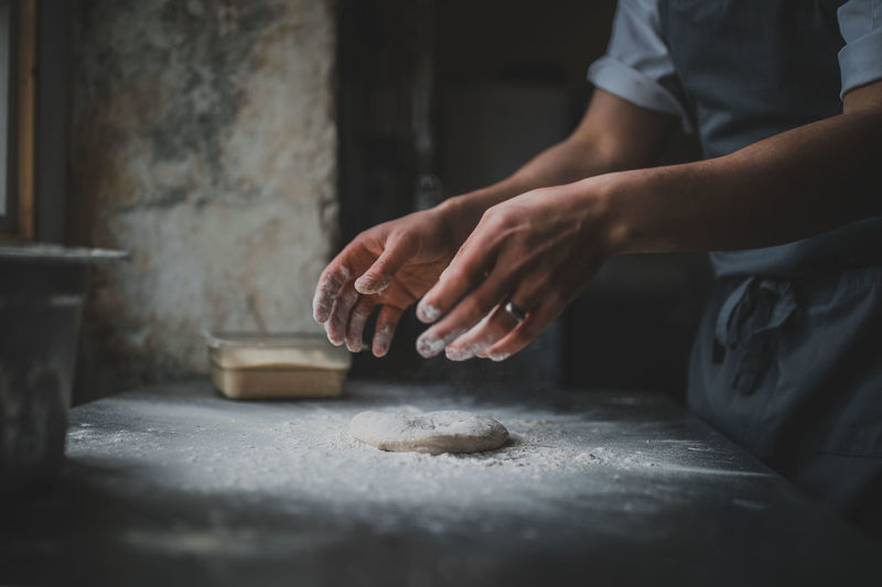 Pizza Dough Chef Dough Flour Food Food And Drink Hand Human Body Part Human Hand Indoors  Kneading Lifestyles Making Men Midsection Occupation People Pizza Pizza Making Preparation  Preparing Food Real People Selective Focus Skill