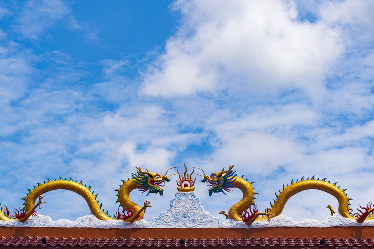 Budhist Temple Dragon Backgrounds Cloud Colors Colorful Still Life Outdoors Temple Buddhist Blue Sky Freshness Day Dragon Sculpture Chinese Dragon Sky Cloud - Sky Extinct Sculpted Human Representation Carving - Craft Product Idol Buddha Art Dinosaur Statue Paleontology Evolution  Prehistoric Era