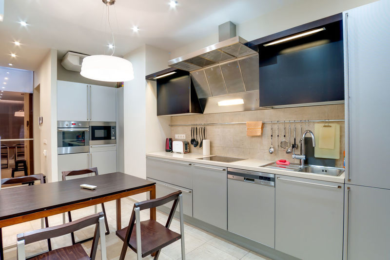 Home Domestic Kitchen Kitchen Domestic Room Modern Furniture Indoors  Home Interior Kitchen Counter Appliance Household Equipment No People Lighting Equipment Home Showcase Interior Stove Seat Microwave Cabinet Oven Flooring Steel Luxury Exhaust Fan Clean