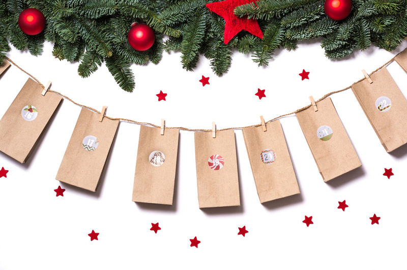 Directly above view of christmas decorations on white background