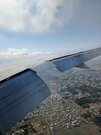 777 on approach to Ezeiza Intl. Airport. Cloud EyeEmNewHere Landing Aerial View Airplane Airplane Wing Architecture Bird's Eye View City Cityscape Cloud - Sky Clouds Clouds And Sky Flap Flaps Landing Stage No People Sky