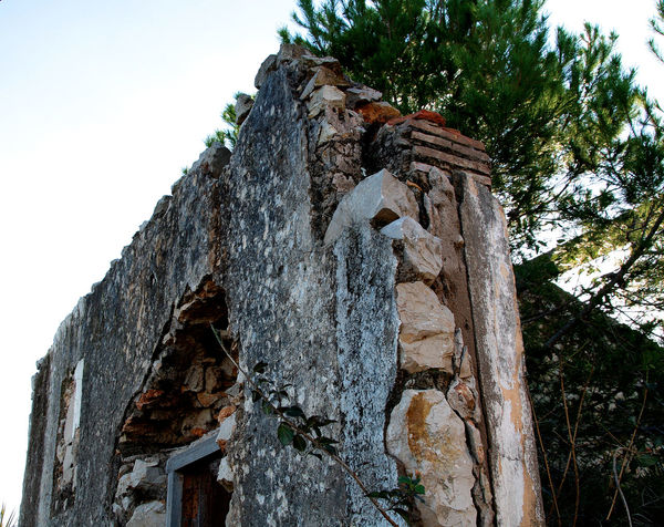 Abandoned Buildings Abandoned House Abandoned Places Architecture Building Exterior Built Structure Countryside Day Daylight Low Angle View Nature No People Outdoors Ruin Ruined Wall Sky Stones Sunnyday Tree