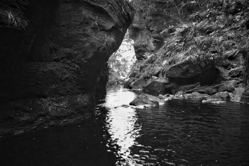 Deep water wading Monochrome Photography Rock - Object Rock Formation Water Geology Scenics Tranquility Physical Geography Beauty In Nature Textured  Nature Cliff Eroded Non-urban Scene Tranquil Scene Natural Arch Stream Natural Landmark Waterfront Devil's Pulpit Scotland