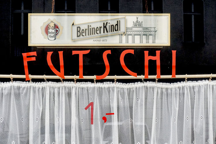 Futschi Advertising in Berlin Kreuzberg Text Western Script Communication Sign Information Capital Letter No People Information Sign Red Day Architecture Close-up Non-western Script Script Outdoors Built Structure Guidance Message Window Alcohol Alcohol Bottles Advertising Public Transportation Berlin Schnaps