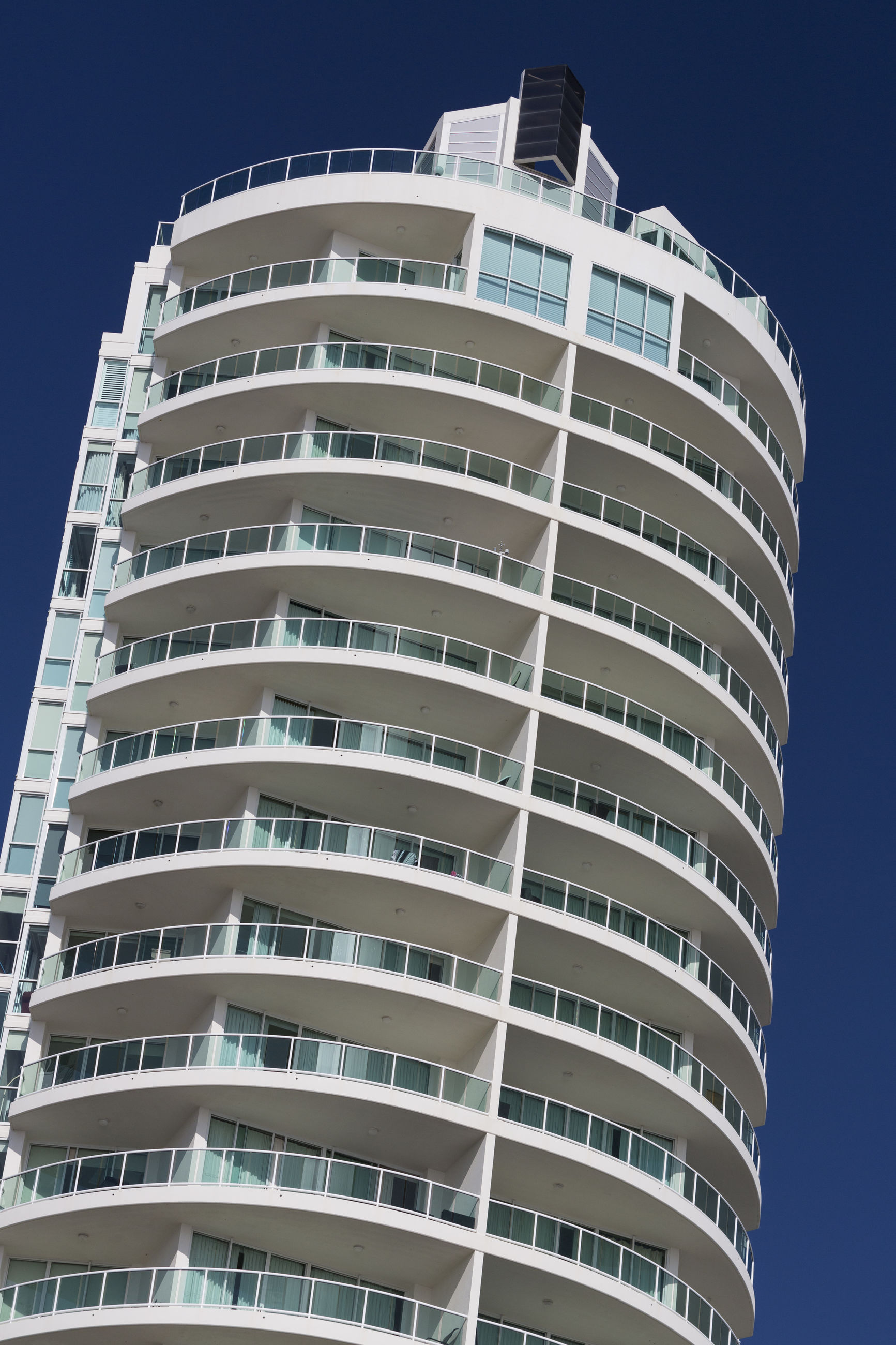 architecture, low angle view, building exterior, balcony, built structure, residential building, apartment, no people, city, day, modern, outdoors, clear sky, residential, sky