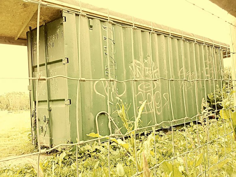 This container was really screaming at me to take a snap, I shot it through the wire fence to give it more of a POW feel. Metal Container Shed Allotment Storage Space Prisoner Of War No People Check This Out Desolated