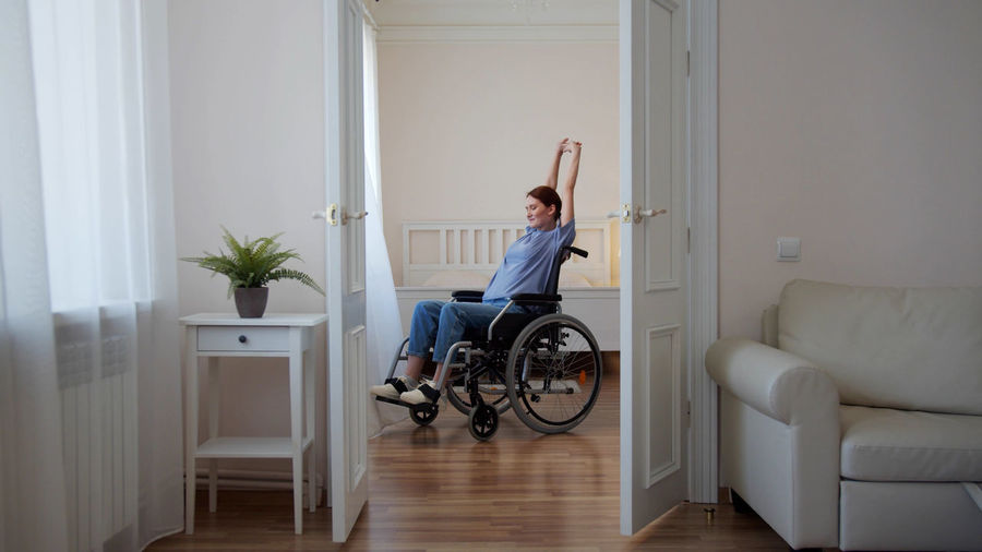 Man sitting on door at home