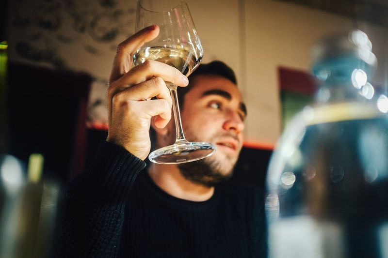 Close-Up Portrait Of Young Man With Drinking Glass