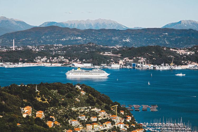 Portovenere, italy giant cruise ship costa crociere in gulf leaving the touristic port of la spezia