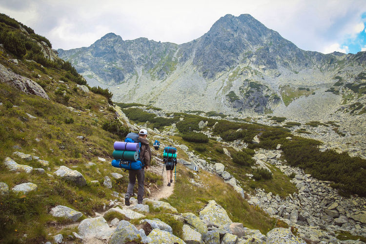 Retezat mountains Adventure Backpack Beauty In Nature Cloud - Sky Day Exploration Friendship Hiker Hiking Leisure Activity Lifestyles Men Mountain Mountain Range Nature Outdoors Real People Rear View Scenics Sky Togetherness Tranquil Scene Tranquility Two People Women