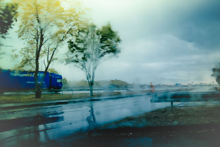 Autobahn Autobahn A 3 Car Cloud - Sky Freeway Highway Mode Of Transport Motion Motorway Station Nature No People Outdoors Rain Rainy Day Reflection Rest Area Road Sky Street Transportation Tree Water Waterfront Weather Wet