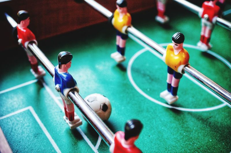Soccer table indoor games of fossball Soccer Fossball EyeEm Selects Competition High Angle View Indoors  Figurine  Teamwork Sport Competitive Sport Football Model Sports Team Playing Day People
