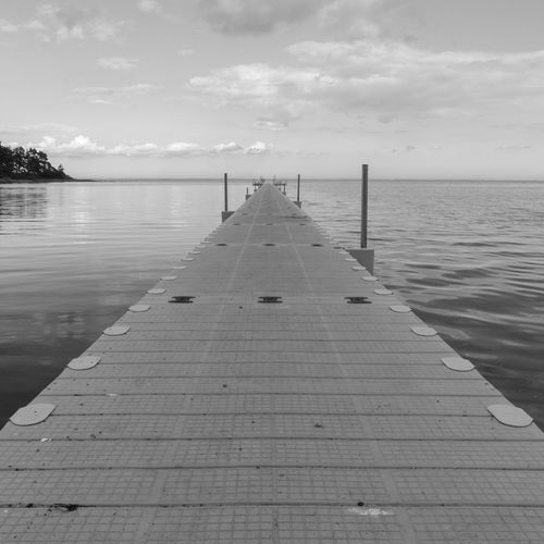 The Week on EyeEm Reflection Sea Water Blackandwhite Sky Bridge Jetty Illusion Pier Tranquility Monochrome Horizon Direction Solution Sverige Projection Planks The Way Forward Horizon Over Water Cloud - Sky Diminishing Perspective Scenics - Nature Paysages Grys