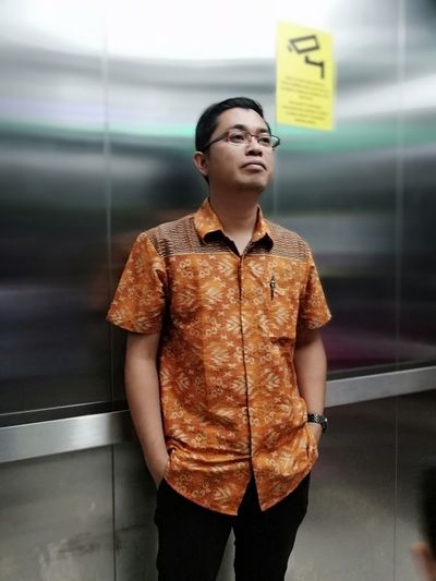 Man looking away while standing in elevator