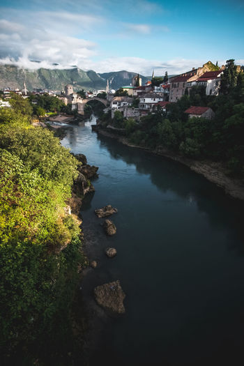 High angle view of river amidst buildings in town