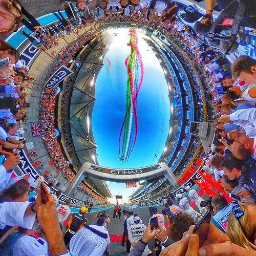 360 Tiny Planet of the Fly past watched by the drivers on the grid, before the start of the final F1 race of the 2017 season, in Abu Dhabi Samsung Gear 360 Group Of People Outdoors People Sky Day Travel Destinations Mixed Age Range Lifestyles Women Men Crowd Real People Large Group Of People Formula 1 F1 Abu Dhabi 360 Panorama Tiny Planet Fly Past Colourful Action Shot  Atmosphere Sports Event