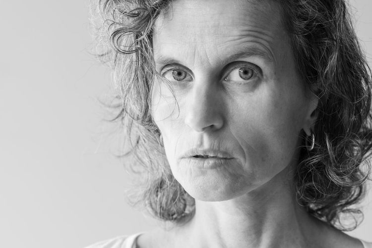 Middle aged woman (black and white) Adult Black And White Body Part Close-up Contemplation Females Front View Hairstyle Headshot Human Body Part Human Face Human Hair Indoors  Looking At Camera Mature Adult Mature Women One Person Portrait Senior Adult Studio Shot White Hair Women