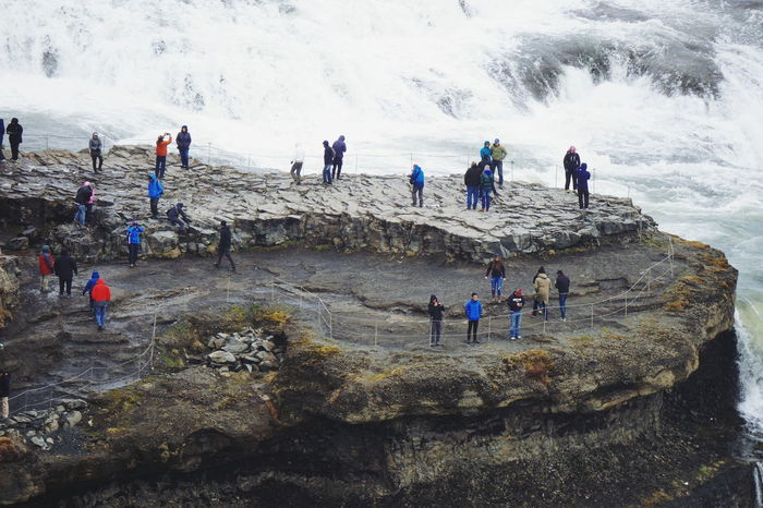Gullfoss waterfall in Iceland Adult Adventure Beauty In Nature Challenge Cliff Climbing Day Extreme Sports Glacial Gullfoss Hiking Iceland Large Group Of People Leisure Activity Lifestyles Mountain Nature Outdoors People Physical Geography Real People Rock - Object Sport Togetherness Water The Great Outdoors - 2017 EyeEm Awards Lost In The Landscape