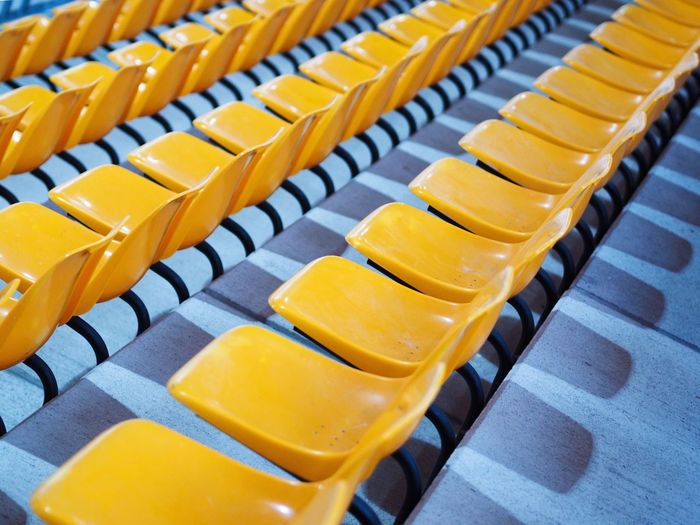 Row of yellow bleachers in stadium