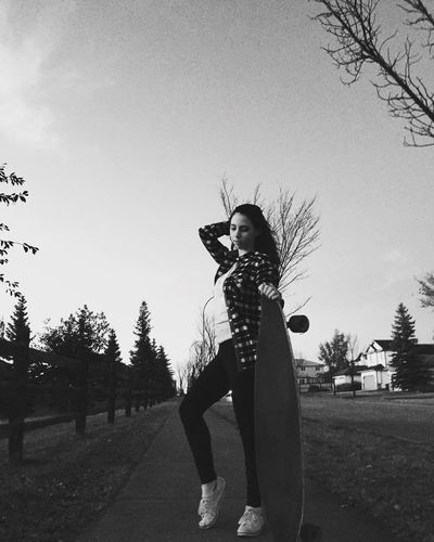 Blackandwhite Longboard Longboarding Modeling Beautiful Tree One Person Casual Clothing Young Adult Young Women Standing Outdoors Sky Clear Sky Day Nature Portrait