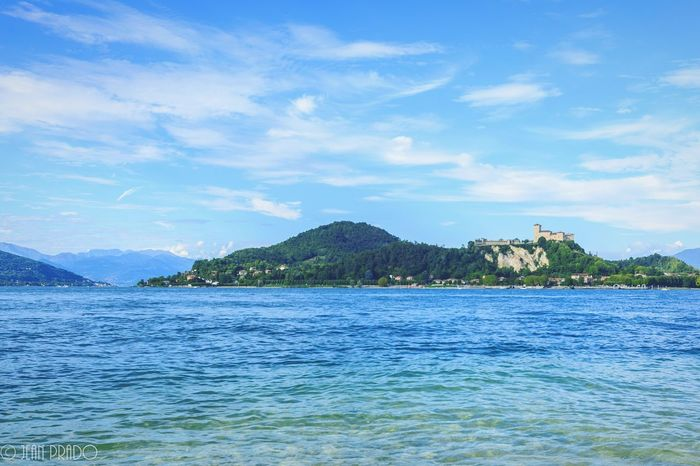 Sky Cloud - Sky Outdoors Blue Water Travel Destinations No People Mountain Travel Landscape Day Summer Italy Arona, Italy Arona Lago Maggiore Lake View Lakeshore Scenics Castle View  Castle Photo Photography Photooftheday