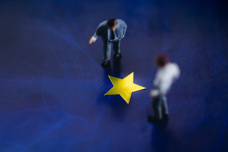 Success in Business or Talent Concept. Top View of Two Miniature Businessman Standing on a Yellow Golden Star. Men Discussing in Successful Topic Successful Talent Concept Miniature Excellence Business Employee Star Businessman Success Talking Discuss Teamwork Boss Best  Happy Manager Potential  Awards Winner Trophy Great Corporate Work Man Executive  Proud Winning Male Prize Honor Champion Rewards Competition Goal Victory Pride Golden Office Reach Journey Figure Sign Closeup Macro Photo Mini Nobody
