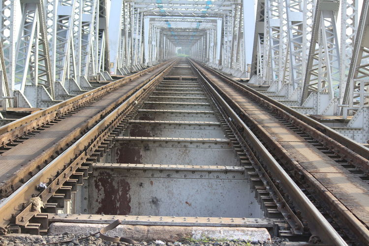 Railway tracks along bridge