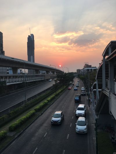 sunset Architecture Transportation City Car Built Structure Building Exterior Road Sunset Sky The Way Forward Land Vehicle Outdoors No People Day
