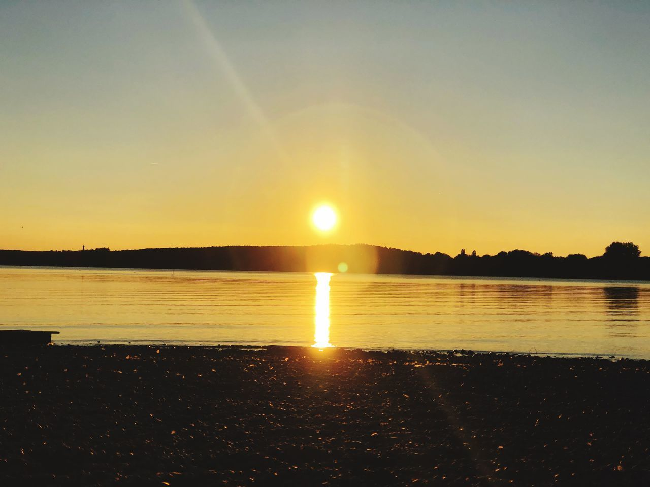 sky, water, sunset, beauty in nature, scenics - nature, tranquility, tranquil scene, sun, reflection, sunlight, nature, no people, idyllic, lens flare, sunbeam, lake, beach, orange color, outdoors, bright