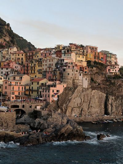 sunsets in Liguria Cinque Terre Colors Colorful Postcard Italy Liguria Sunset Golden Hour Sea Seaside Cliffs Cliffside Village Travel Destinations Travel Exploring Discovery EyeEm Selects Cityscape City Urban Skyline Business Finance And Industry Barrel City Street Community Sky TOWNSCAPE Coast Horizon Over Water Shore