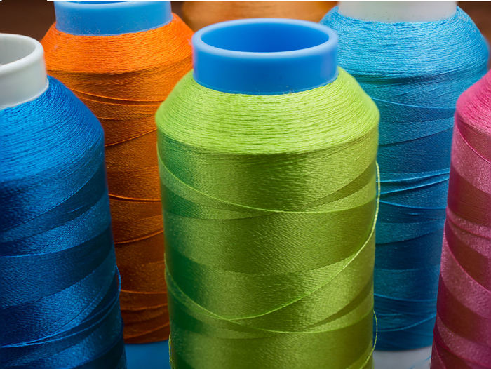 Closeup spools and colored thread sewing for craftsman work.Selective focus colorful thread ,silk Background Bobbin Close-up Clothes Craft Design Fabric Handmade Needle Object Sewing Spool Stitching Thread Vivid Yarns