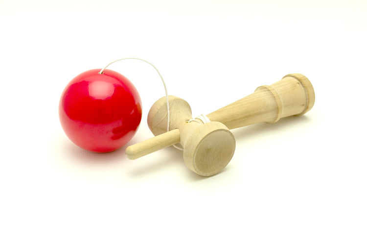 kendama Japanese  Close-up Garden Gavel Indoors  Kendama, Toy, Japan, White, Background, Japanese, Traditional, Ball, Wooden, Old, Wood, Fun, Red, Object, Game, Vintage, Isolated, Play, Rope, Retro, Classic, String, Culture, Antique, Hole No People Red Studio Shot Toy Traditional Vintage White Background Wooden