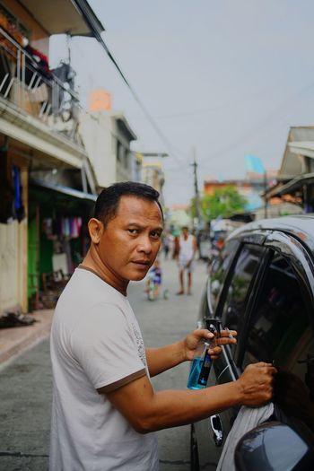 Man standing on street in city
