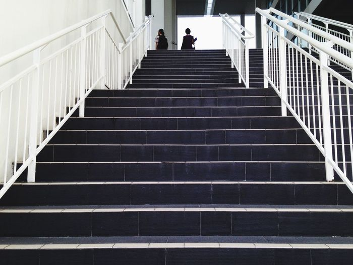 Low angle view of people walking on stairs