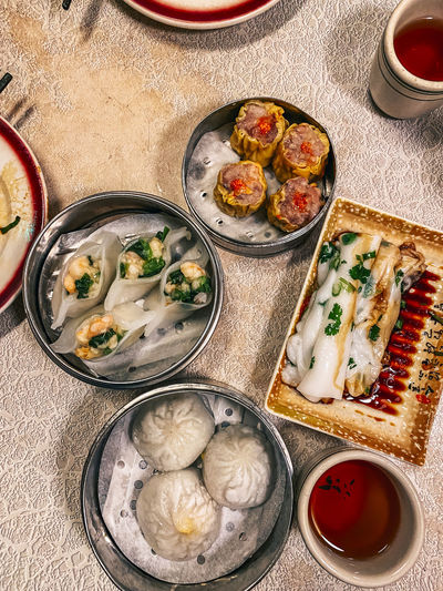High angle view of dim sum food served on table